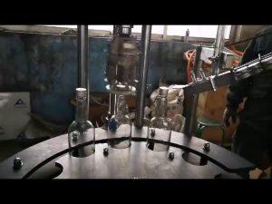 kommersiell automatisk tappemekanisme for tapping og tetting av aluminium